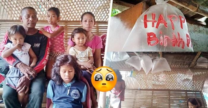 Niños sin dinero, usan bolsas de plástico para festejar el cumpleaños de su papá.